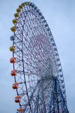Colorful ferris wheel isolate against blue sky stock image