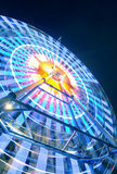 A colorful ferris wheel at night Stock Images