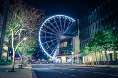 Colorful Ferris wheel in night time stock photography