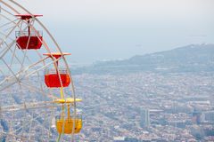 Colorful Ferris Wheel. This photo shows a part of a ferris wheel. In the background the city of Barcelona can be seen Royalty Free Stock Photography