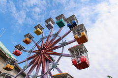 Colorful ferris wheel in the playground Stock Photos