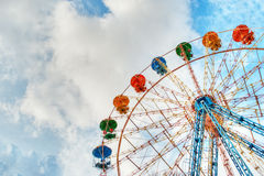 Colorful ferris wheel and sky Stock Photos