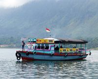 Colorful ferry boat. On the Indonesian Lake Toba. Ferries cross many times daily between Sumatra`s mainland and Samosir island, a popular tourist destination stock image