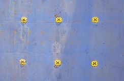 Colorful ferry car deck flooring in blue painted metal. With yellow knobs stock image