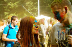 Colorful Festival HOLI in Moscow, Park Fili, 29.06.2014. People laughing at the festival of paints - one of the most colorful the Indian festival, Bengali new Royalty Free Stock Image