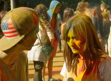 Colorful Festival HOLI in Moscow, 29.06.2014. People laughing at the festival of paints - one of the most colorful the Indian festival, Bengali new year. People Stock Photo