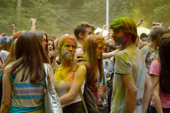 Colorful Festival HOLI in Moscow, 29.06.2014. People laughing at the festival of paints - one of the most colorful the Indian festival, Bengali new year. People Royalty Free Stock Photography