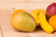 Colorful festive assortment of mango and bananas Royalty Free Stock Photos
