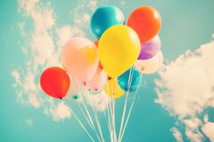 Colorful festive balloons over blue sky stock photo