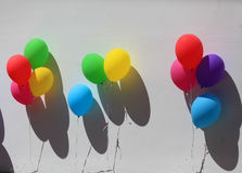 Colorful festive balloons on wall Stock Image