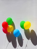 Colorful festive balloons on wall Stock Photos