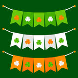 Colorful festive bunting with clover on green background. Colorful festive bunting set with clover on green background Stock Photography