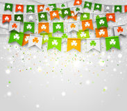 Colorful festive bunting with clover on light background. Saint Patrick`s Day. Colorful garlands of flags with clover on light background. Irish holiday - happy Stock Photo