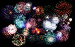 Colorful fireworks of various colors in night sky Stock Image