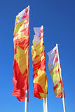 Colorful festive flags waving in the wind Royalty Free Stock Images