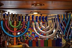 Colorful festive menorah and multi-colored jewish candlesticks on the shop window in Jerusalem, Israel royalty free stock images