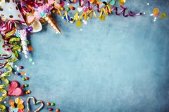 Colorful festive party border on textured blue royalty free stock photo