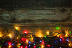 Colorful festoon on the wooden board Stock Images