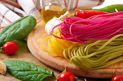 Colorful fettuccine pasta and cooking ingredients Stock Image