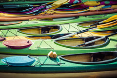 Colorful fiberglass kayaks tethered to a dock as seen from above Royalty Free Stock Photos