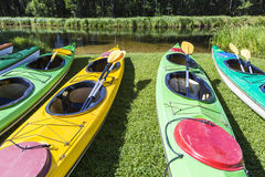 Colorful fiberglass kayaks tethered to a dock as seen from above Stock Photo
