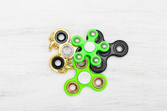 Colorful Fidget finger spinner stress, anxiety relief toy. Flat aly stock photography