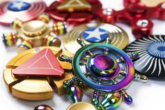 Fidget finger spinners stress, anxiety relief toy. Colorful Fidget Spinners background. Anxiety relief toys royalty free stock images