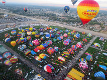 Colorful Field of Hot Air Balloons Launching Stock Images