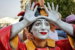 Colorful figure of a clown with arms raised royalty free stock photography