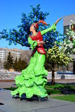 Colorful figure featuring dancing women in Astana Stock Photo