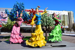 Colorful figures featuring dancing women in Astana Stock Images