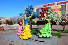 Colorful figures featuring dancing women in Astana Royalty Free Stock Image
