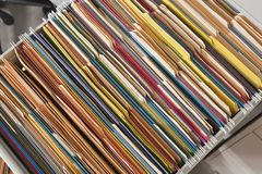 Colorful Files. Packed file cabinet with colorful hanging file folders Stock Photo