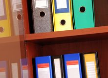 Colorful files in office shelf Stock Images