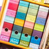 Colorful files on shelf. With captions: Love, Hope, Dream, Dance royalty free stock images