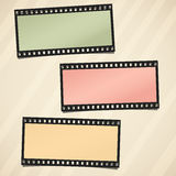 Colorful film or camera strips on light striped brown background.  Royalty Free Stock Photography