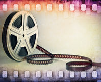 Colorful film strip, film reel background. Colorful film strip and film reel background Royalty Free Stock Photography