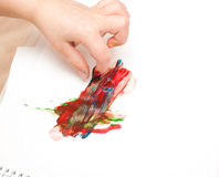 Colorful finger paints over on white paper Royalty Free Stock Image