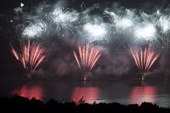 Colorful firework above the lake water Stock Photography