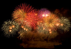 Colorful firework display. Colorful fireworks display happy new year 2011 at Chiangmai province Thailand Stock Photo