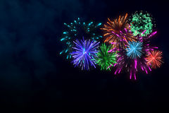 Colorful firework on midnight blue sky. For celebration content. background design. illustration Stock Image