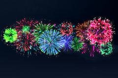 Colorful firework on midnight blue sky Stock Image