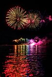 A colorful firework with reflection royalty free stock photo
