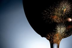 Colorful fireworks against the black silhouette of a wine glass close-up. stock photography