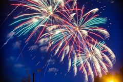 Colorful fireworks on background night sky. The explosions of the salute from the pyrotechnics. Colorful fireworks on the background night sky. The explosions of stock photos