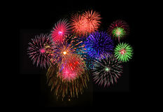 Colorful fireworks on black background. Stock Images