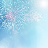 Colorful fireworks on blue bokeh background Royalty Free Stock Photos