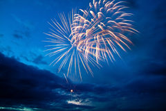 Colorful fireworks on the blue cloudy sky Royalty Free Stock Photos