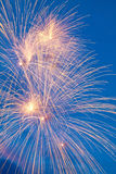 Colorful fireworks on the blue cloudy sky Royalty Free Stock Photo