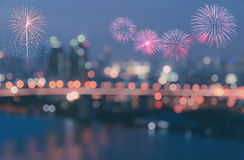 Colorful fireworks on blurred bokeh city lights background Stock Image